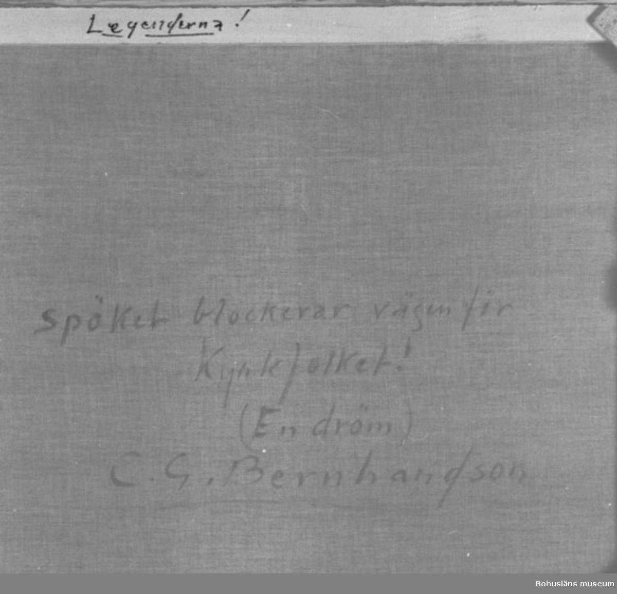 """Baksidestext:  """"Spöket blockerar vägen för Kyrkfolket! (En dröm) C.G. Bernhardson."""" På ramens övre kant: """"Legenderna!""""  Litt.: Bernhardson, C.G.: Bohuslän - från Wämmer och Kräppe, Uddevalla, 1983, s. 19. Saknar titel i boken: """"Spöket reder sig bra trots besvärjelser.""""  Övrig historik; se CGB001."""