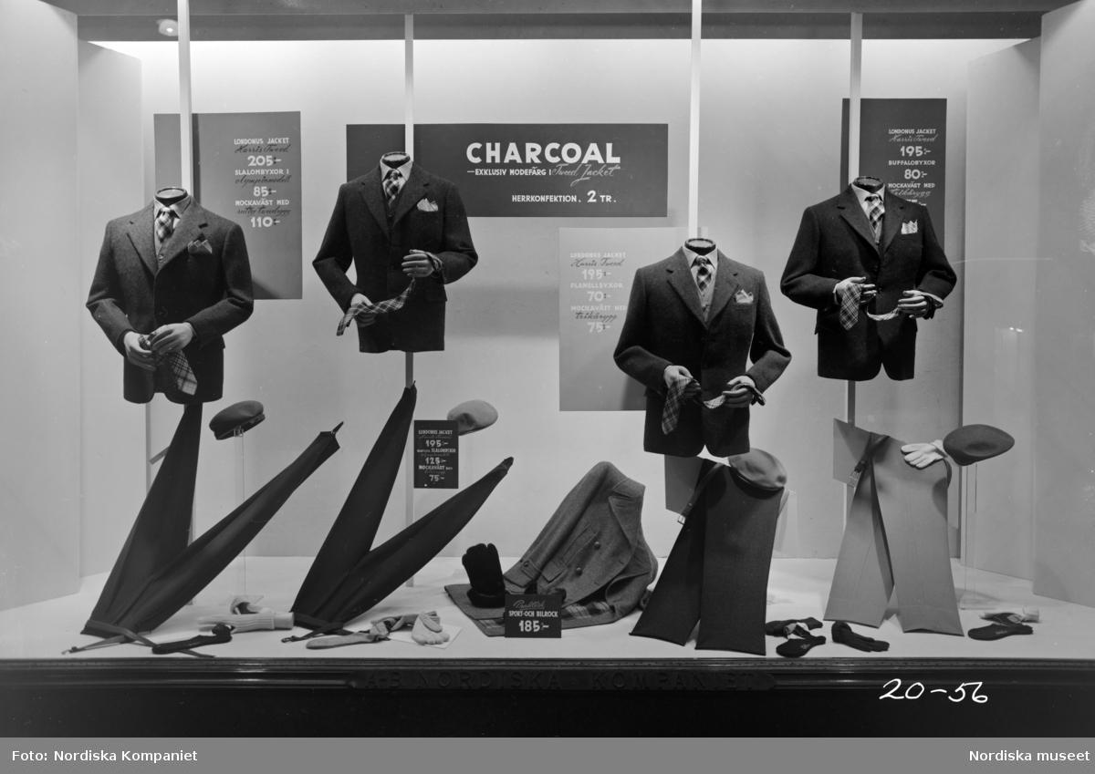 Skyltfönster på Nordiska Kompaniet. Charcoal. Kavajer och byxor i tweed.