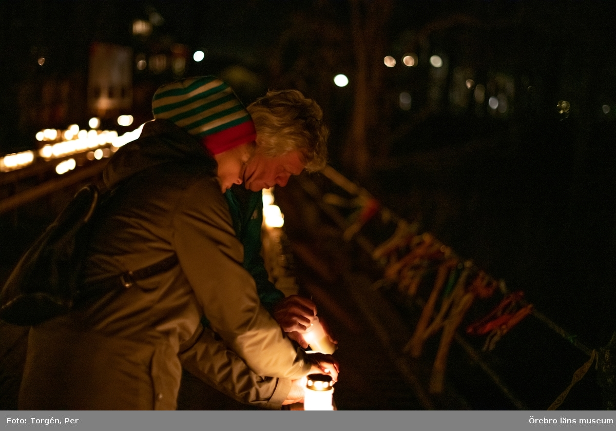 Ljusmanifestation mot rivningen av Järle kvarndamm 10 december 2020.