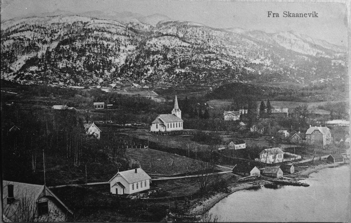 Postkort med landskapsmotiv frå Skånevik i Etne sett mot sørvest, ca. 1910.