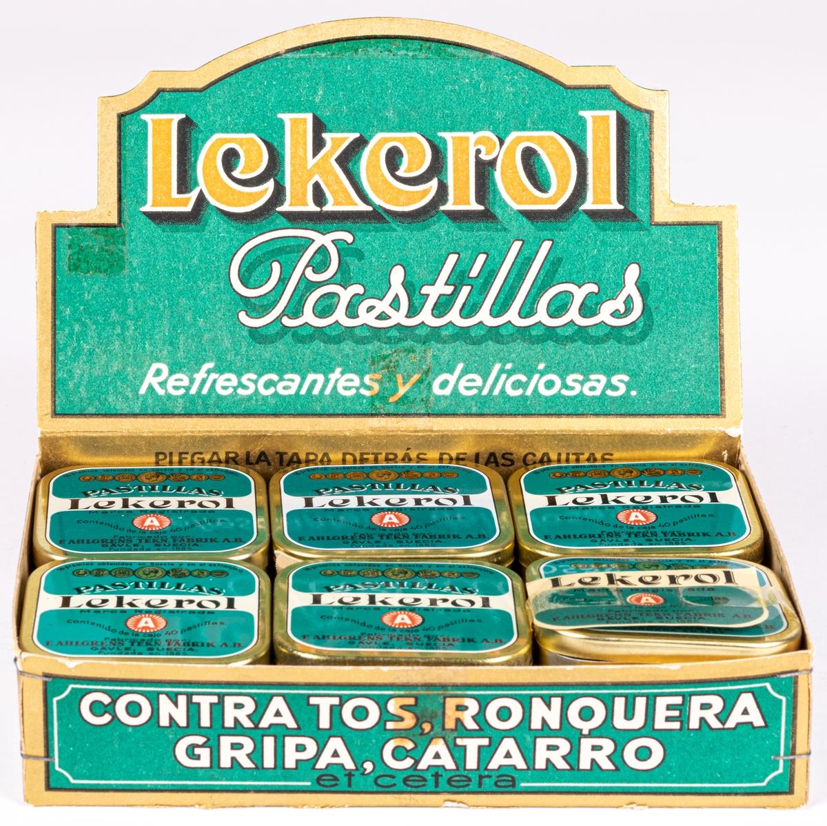 """Reklamställ i papp för tablettaskar, innehållande tolv tablettaskar i plåt med texten: """"LEKEROL PASTILLAS REFRESCANTES Y DELICIOSAS."""""""