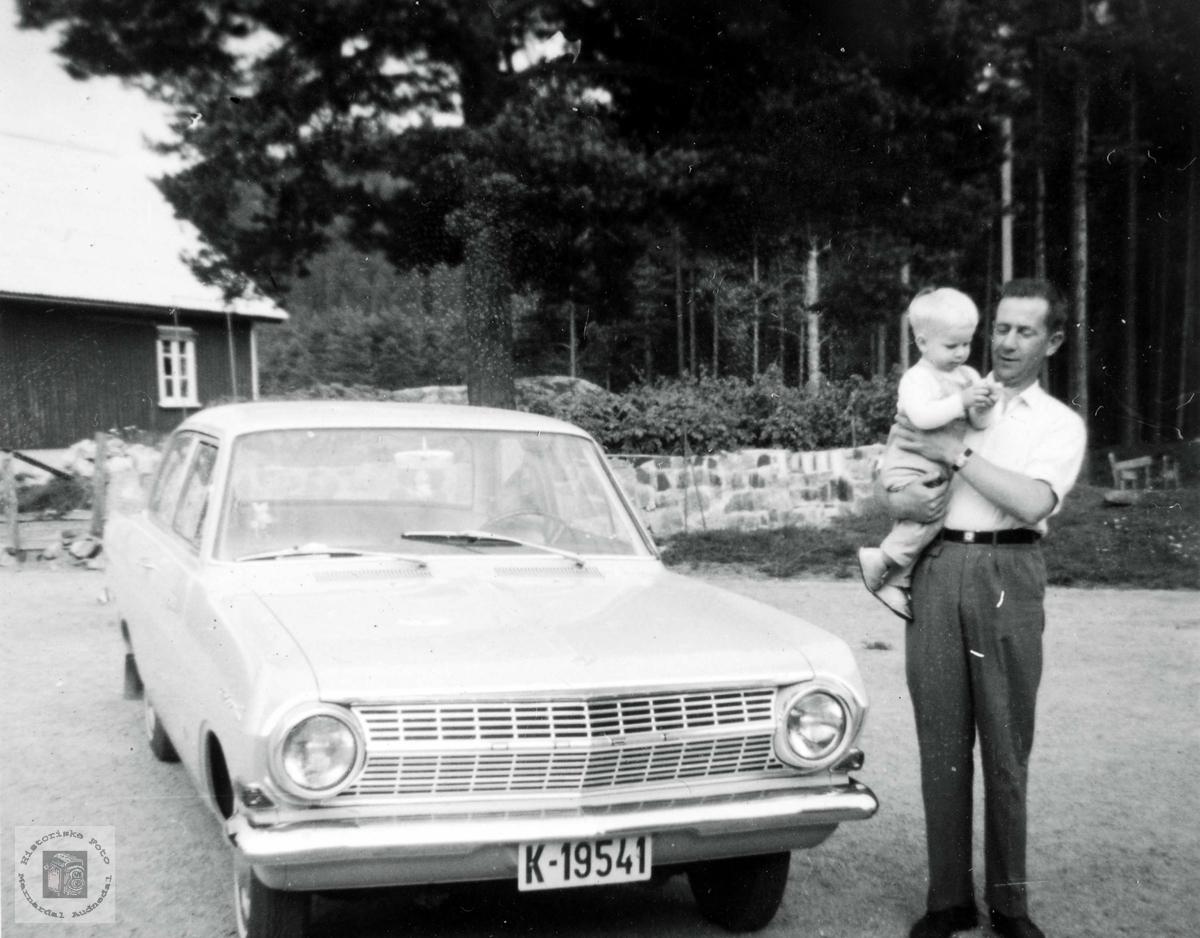 Theodor Werdal og Vidar Fjellestad og Opel. Grindheim Audnedal. Bilen:  Opel Rekord modell A, årsmodell 1963-65.
