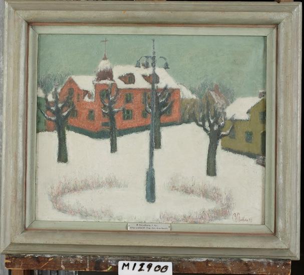 Litet torg med byggnader i snö.