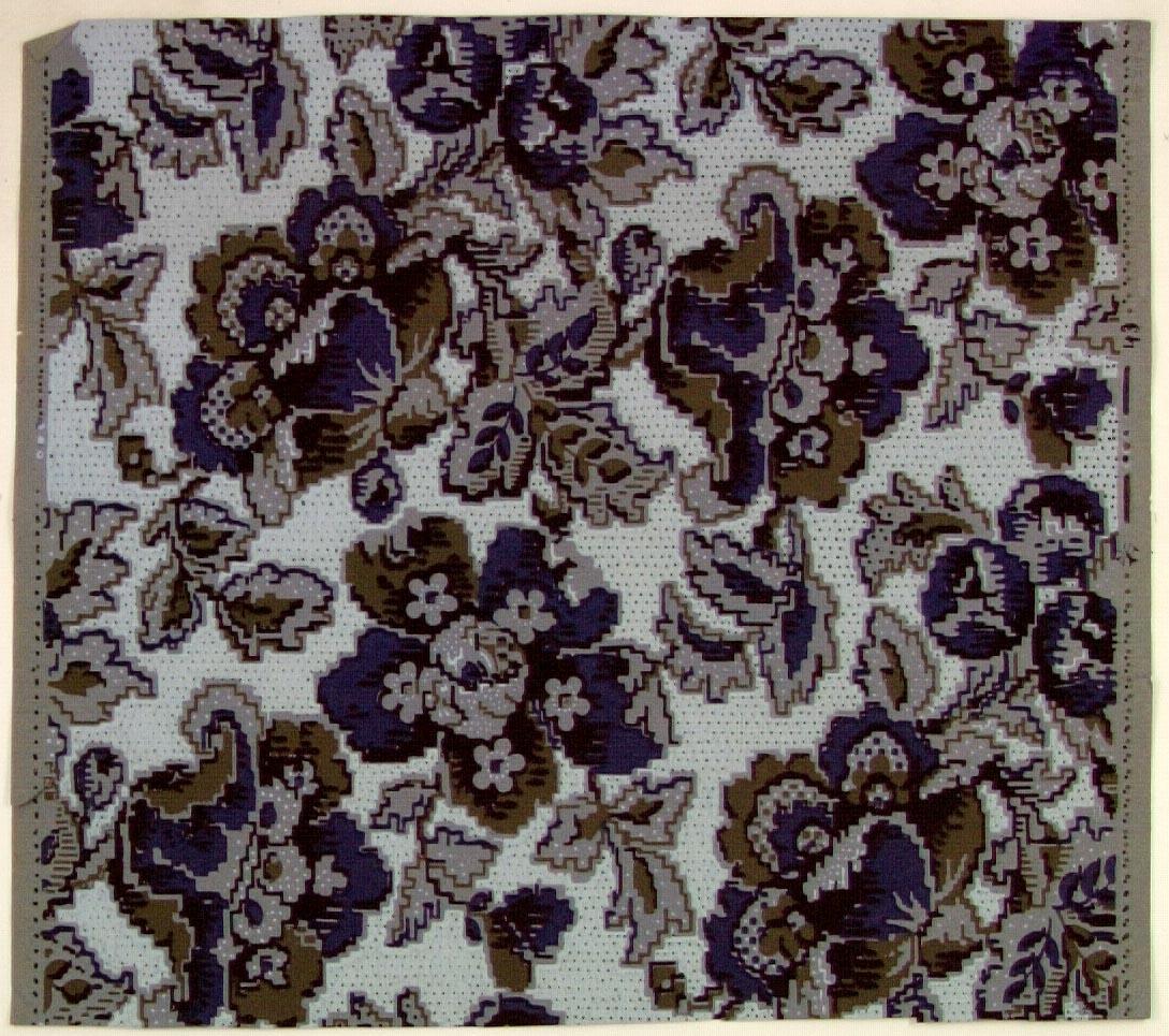 Ett ytfyllande silhuett-/blommönster i flera blå nyanser på ett gråblått genomfärgat papper. Övertryck med prickmönster.