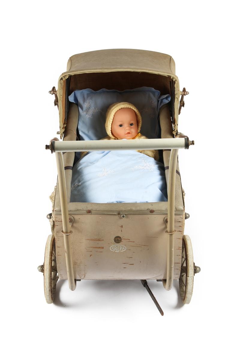 Barnevogn med sengetøy