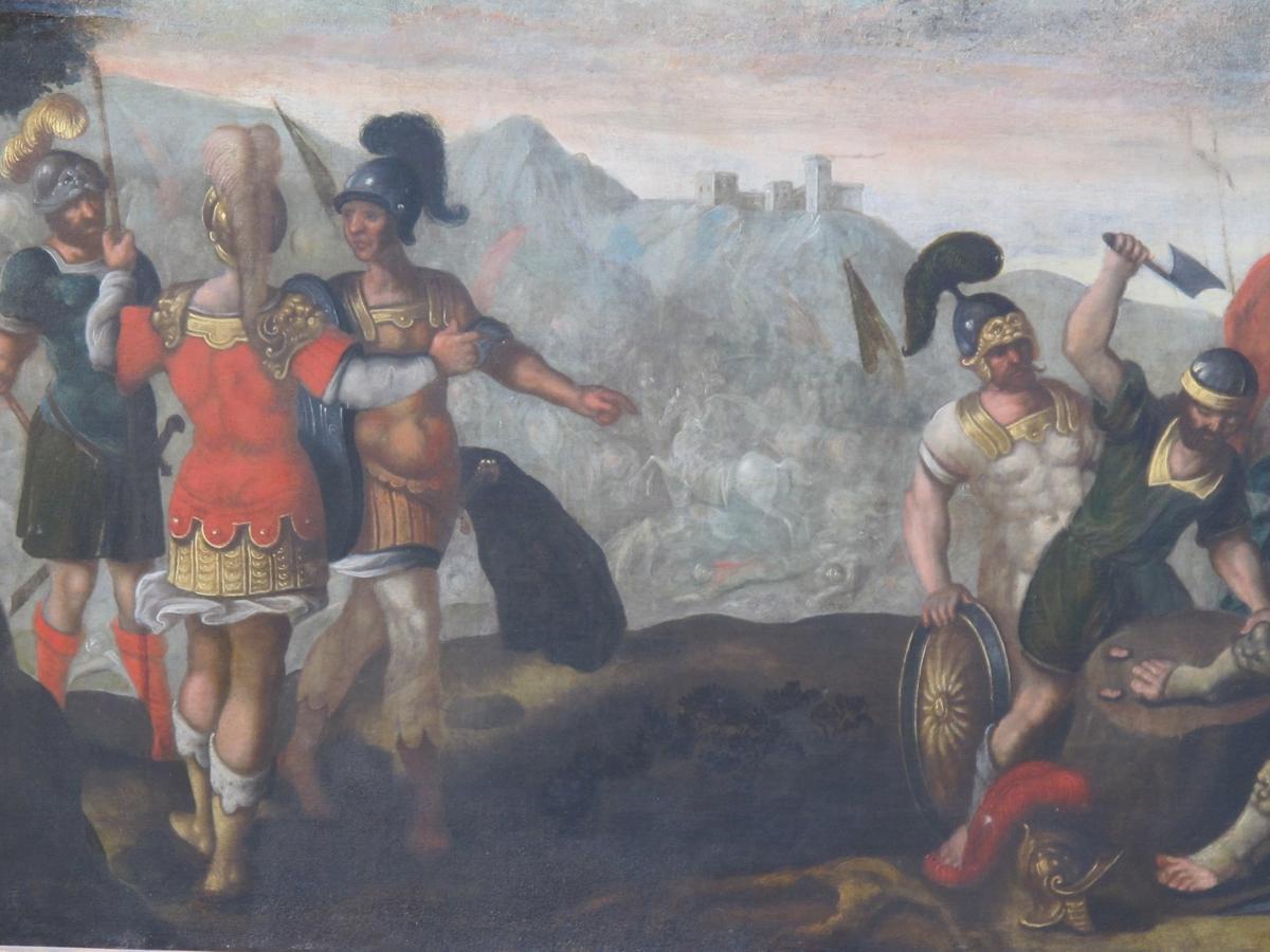 """Adoni-Beseks lemlestelse; tærne blir hugget av en konge /kjempe.  Helt t. v. i forgrunnsplanet står tre krigere i samtale, mannen. i midten, med  ryggen  til, er sanns. en  konge eller stor hærfører, prektig kledd i forgylt paneer, med skarlagenrød  skjor  te over, og gullhjelm,'  Deres oppmerksomhet er rettet mot høyre, den ene av  de to menn peker og ser dit, mens den prektig kledte  gjør en avvergende gestus. I høyre del av billedet  sees en hop krigere samlet omkring en halvt liggendb  halvt sittende kjempestor mann med krone på hodet, en konge som har tapt et  slag  ? som man holder på å hugge tærne av på.  Hans to tommelfingre ligger alt på trestubben som brukes som huggestabbe. En  kriger  i forgylt rustning støtter kongen, som ser hen mot gruppen av tre menn i venstre halvdel av bilde l,"""" og strekker armen ut mot dem, ber om nåde eller lign. Soldater, lanser og rød fane i bakgr. Helt t. h. oppsalet hest med oppasser, i  forgr. Trær som sidekulliser, slagmark med rytterkamp og falne i bakgr. t. v. Mot  himmelen  lave fjell med en borg.  Bildets øvre del med himmel og lansespisser er skjøtt til, sannsynligvis senere"""