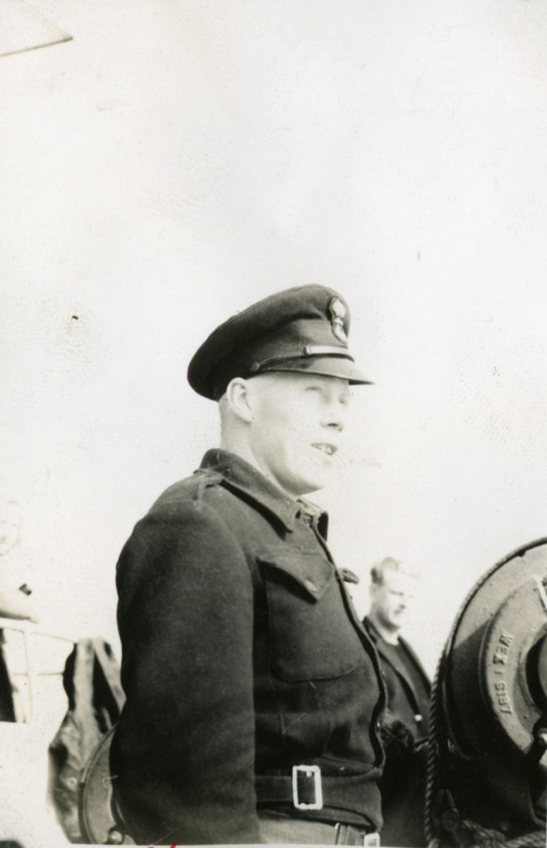 "Album Glaisdale H.Nor.M.S. ""Glaisdale"". Fotograf: Ltn.Knudtzon. En av skipets kvartermestere."